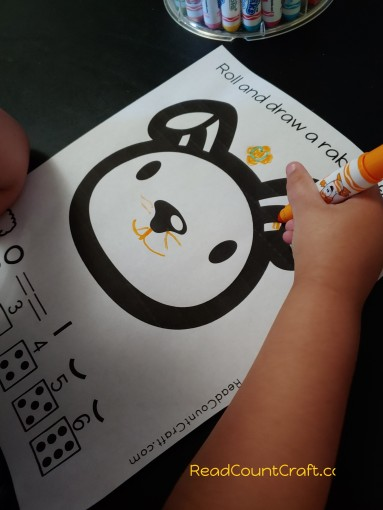 preschool math game roll a rabbit face